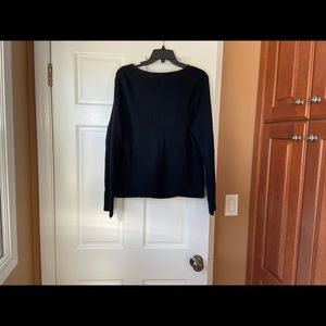 Ladies black sweater with zippers.